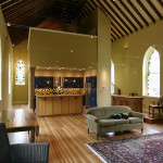 Viewed from the opposite end, the loft master bedroom, track lighting and the original pulpit can be seen.