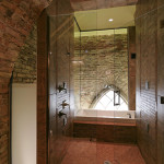 The master walk-through shower to the whirlpool tub is surrounded by frosted glass and stained glass windows.