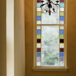Kitchen and accent colors throughout the interior are inspired by the fully restored stained glass windows.