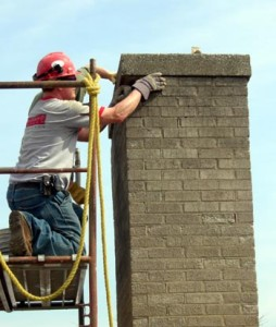 Jeff of Spray-O-Bond finds the courtyard chimney can be disassembled by hand!