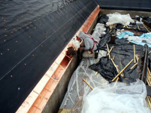 New copper gutters are installed in the Courtyard over two rows of ice & water shield and two layers of roofing felt.