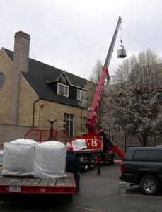 The new shingles are delivered and some are placed on the Ed Building flat roof.