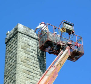 Repairs on the boiler chimney begin.